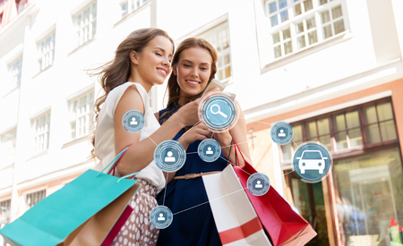 women shopping and using car sharing on smartphone