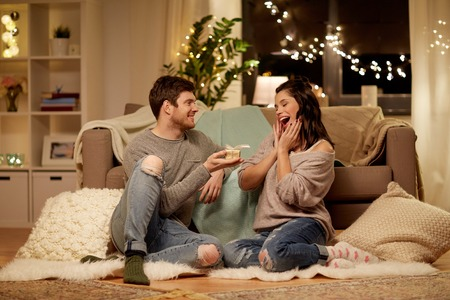 happy couple with gift box at home