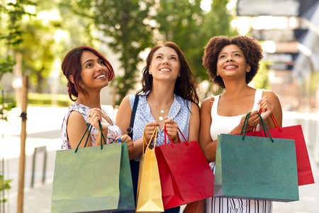 happy women with shopping bags in city Stok Fotoğraf