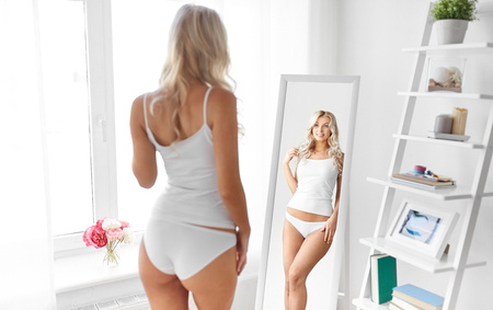 woman in underwear looking at mirror in morning Stock fotó - 110910449