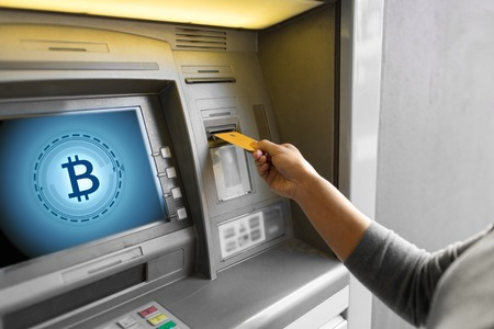 close up of woman inserting card to atm machine Stock Photo