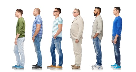 group of diverse men standing in line Stockfoto