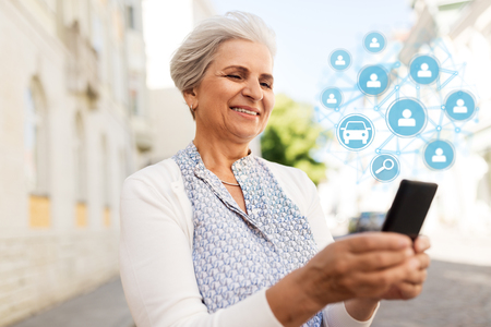 senior woman with smartphone and car sharing icons