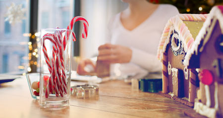 close up of candy canes and gingerbread houses