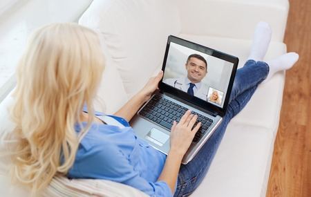 patient having video call with doctor on laptop 스톡 콘텐츠