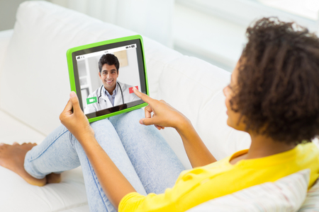 patient having video chat with doctor on tablet pc 스톡 콘텐츠 - 111107875