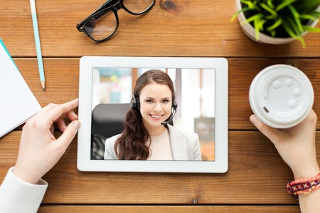close up of woman having video call on tablet pc