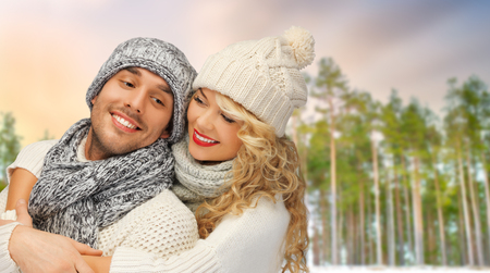 couple hugging over winter forest background