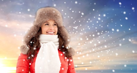 happy woman in winter fur hat outdoors Stock Photo