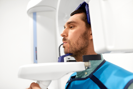 patient having x-ray scanning at dental clinic