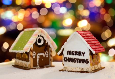 gingerbread houses over christmas lights