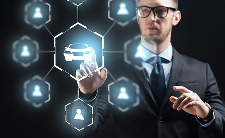 businessman with virual hologram of car sharing