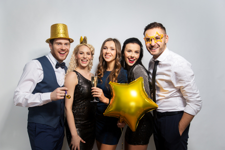 happy friends with golden party props posing