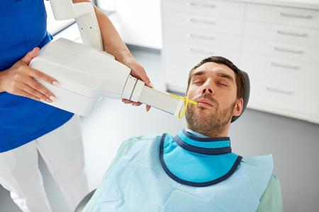 dentist making dental x-ray of patient teeth