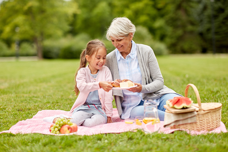 grandmother and granddaughter at picnic in park Archivio Fotografico