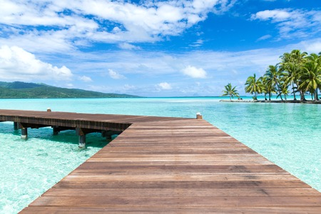 wooden pier on tropical beach in french polynesia Reklamní fotografie