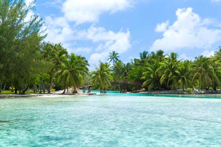 bridge on tropical beach in french polynesia Stock Photo
