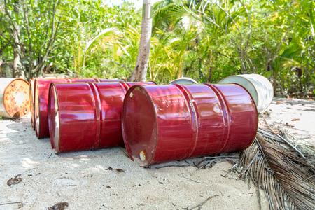 oil drum barrels on beach in french polynesia
