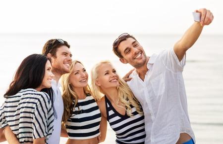 happy friends taking selfie on summer beach