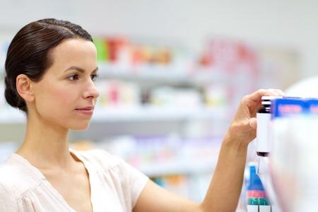 female customer choosing drugs at pharmacy Reklamní fotografie