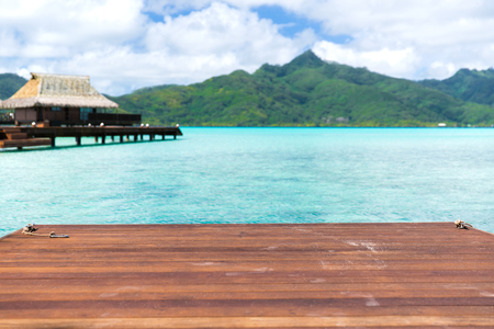 wooden pier and bongalow in french polynesia