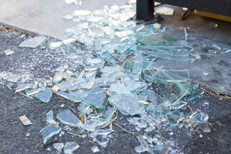 shards of broken glass on floor Stock Photo