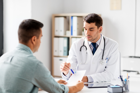 doctor showing prescription to patient at hospital Stock Photo
