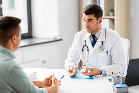 doctor with glucometer and patient at hospital Stock fotó - 112406589