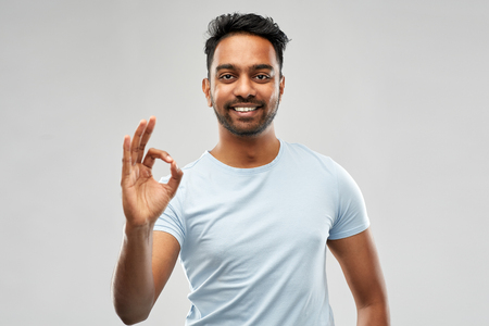 happy indian man in t-shirt showing ok hand sign