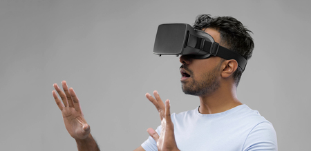 man in virtual reality headset or vr glasses Stock Photo