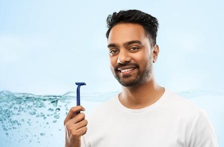 indian man shaving beard with razor blade 写真素材