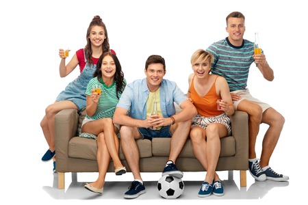 friends or soccer fans with ball and drinks Stock Photo