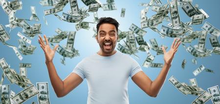indian man celebrating triumph over money falling