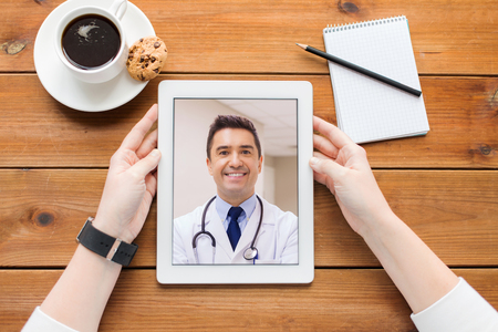 patient having video call with doctor on tablet pc