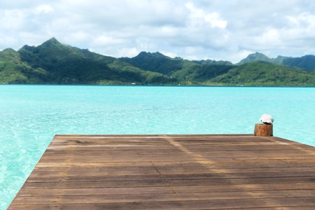 wooden pier on tropical beach in french polynesia Stock Photo
