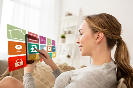 woman with tablet computer and smart home icons Stock Photo