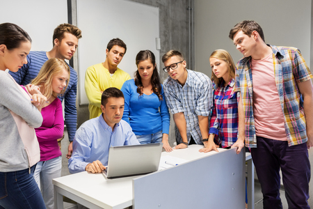 students and teacher with laptop at school Standard-Bild