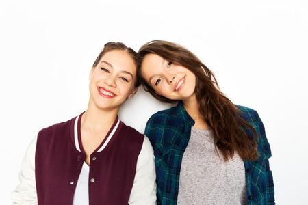 happy smiling teenage girls over white background