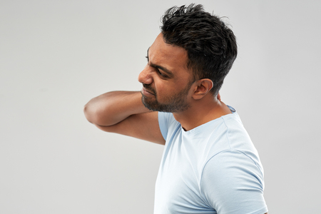 unhealthy indian man suffering from neck pain Stock Photo