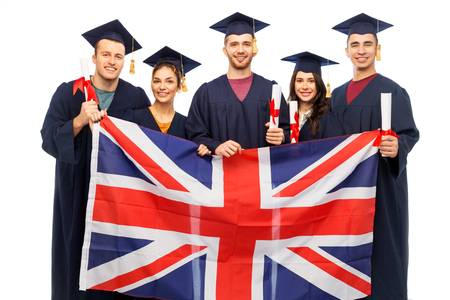 graduate students with diplomas and british flag Stock Photo