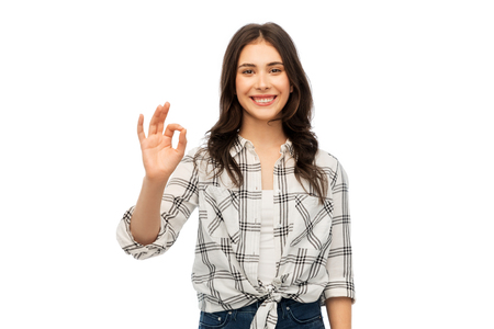 young woman or teenage girl in checkered shirt