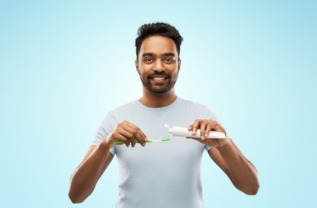 indian man with toothbrush and toothpaste Stock Photo