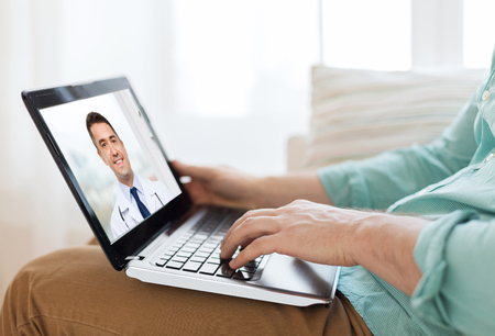 patient having video call with doctor on laptop Imagens