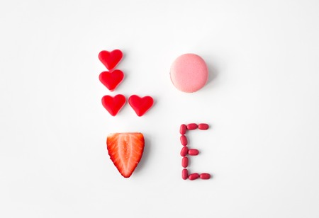 close up of word love made of sweets