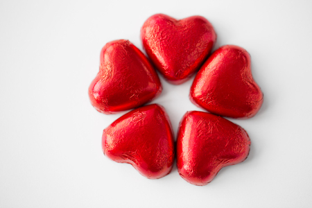 close up of red heart shaped chocolate candies