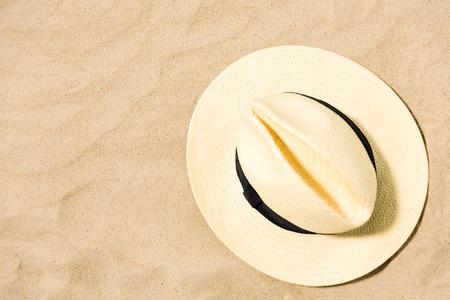 straw hat on beach sand