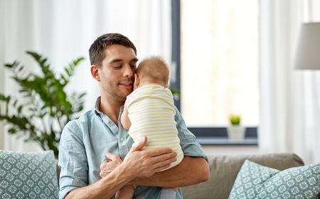 father with little baby daughter at home Stock Photo