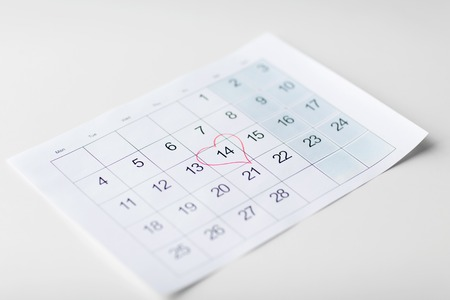 valentines day and holidays concept - close up of calendar sheet with 14th february date marked by red heart shape Stock fotó