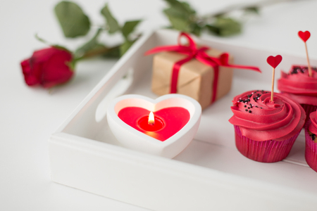 close up of candle and cupcakes for valentines day