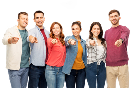 group of smiling friends pointing at you over